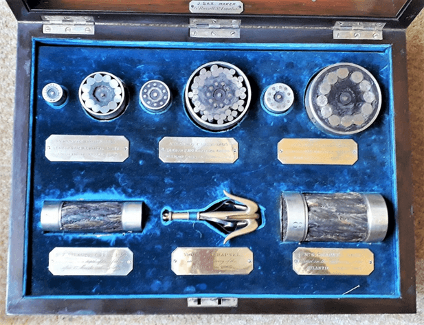 Webster and Horsfall presentation case, showing samples of the 1858, 1865 and 1866 cables, including a scaled-down replica of the grappling hook successfully used to retrieve the 1865 cable.